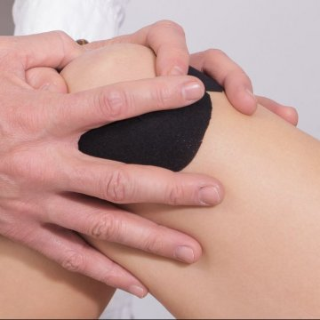 knie-fysiotherapeut-tape